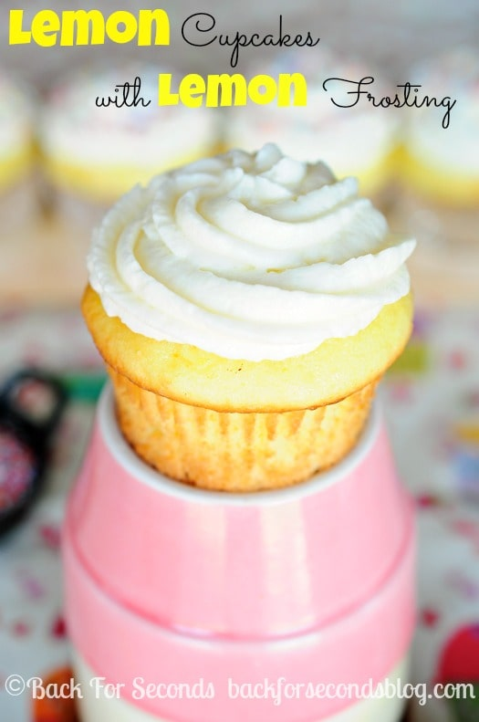 Light and Fluffy Lemon Cupcakes with Lemon Frosting made from scratch! http://backforseconds.com #cupcakes #lemon #dessert