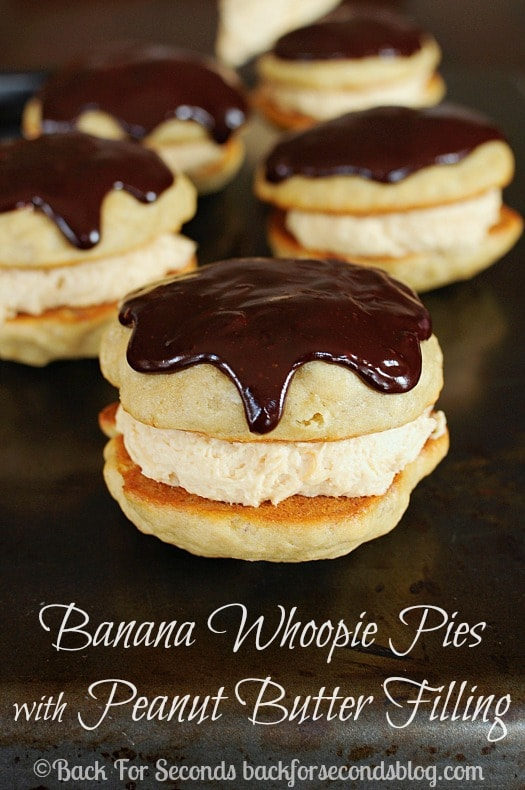 Homemade Banana Whoopie Pies with Peanut Butter Cream Filling - These are AMAZING!!! #bananacake #peanutbutterdessert #dessert