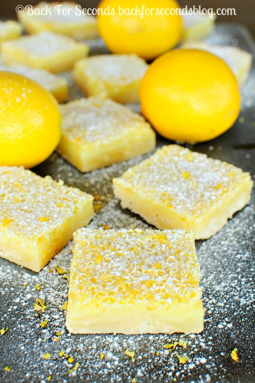 The Best Ever Lemon Bars - SERIOUSLY. Look no further, these are the best!  #dessert #lemonbars #lemondessert