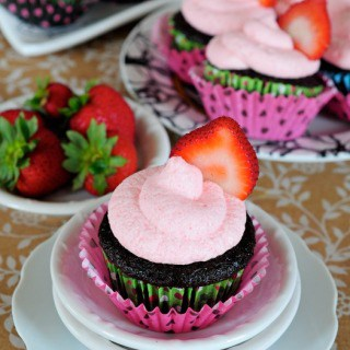 homemade chocolate cupcakes with strawberry frosting