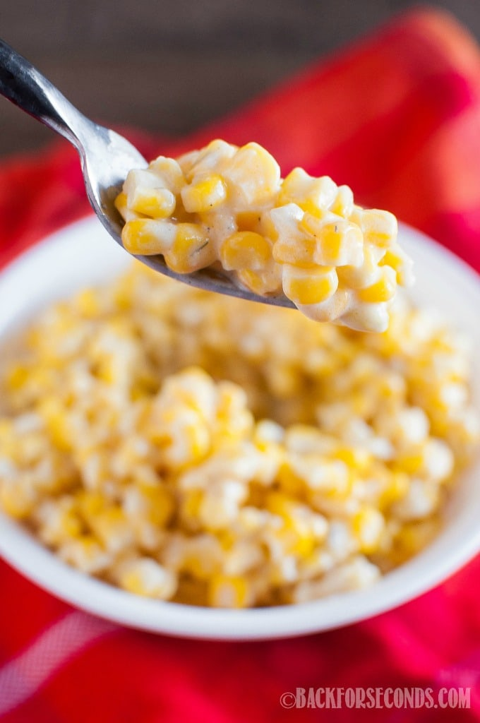 The BEST EVER Creamy Corn made in the Croc Pot!! This is a long time family favorite holiday side dish. Great for Thanksgiving and Christmas!