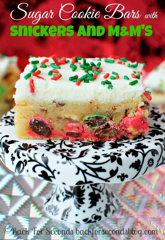 Looking for an easy treat to make for Christmas that everyone will love? Try these Frosted Sugar Cookie Bars with Snickers and M&M's!