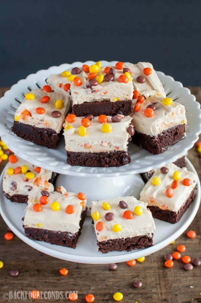 Reese's Pieces Peanut Butter Cheesecake Brownies are chocolate peanut butter heaven! The no bake cheesecake is the perfect topping to these fudgy brownies!