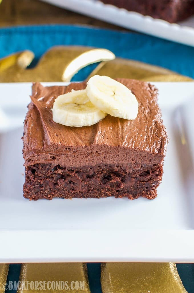 Banana Brownies with Peanut Butter Fudge Frosting are a decadent use for overripe bananas. Chocolate banana brownies are topped with a rich, creamy frosting