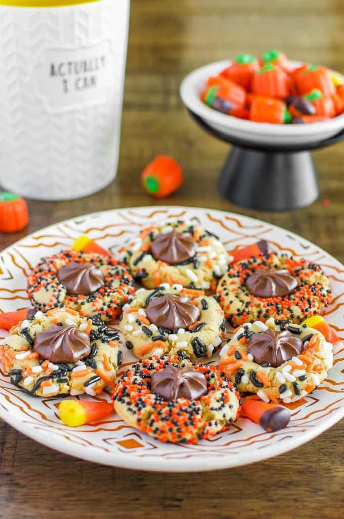 Chewy Halloween Sprinkle Cookies are so fun and festive, with a milk chocolate center! A secret ingredient sets them apart form all other sprinkle cookies!