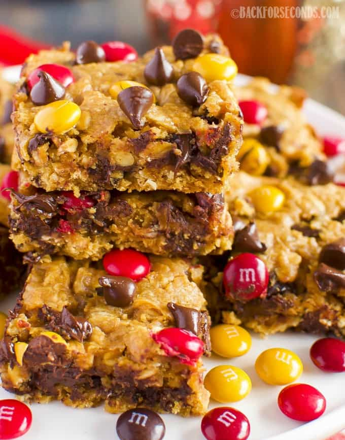 Chewy Pumpkin Monster Cookie Bars are like the classic monster cookie, but with a pumpkin spice twist that makes them the perfect easy dessert for fall!