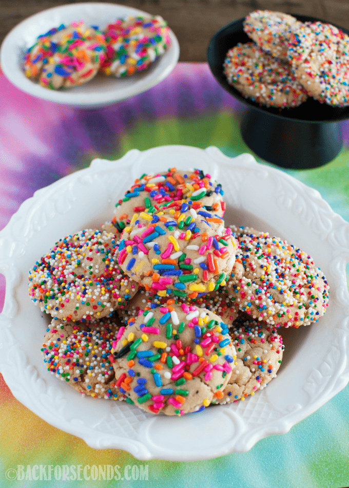 Chewy Rainbow Sprinkle Cookies are so fun and festive, with (or without) a milk chocolate center! A secret ingredient makes them completely irresistible!