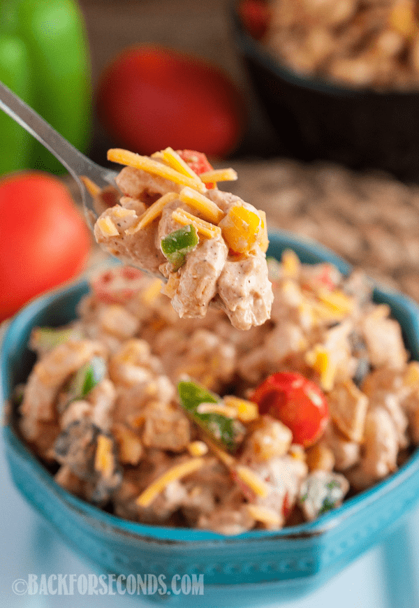 This Taco Chicken Pasta Salad is a super easy lunch or light dinner recipe - especially in the warmer months! Your summer needs this craveable twist on a classic side dish. Add as little or as much spice as you like to the simple homemade dressing for the perfect recipe for cookouts, picnics, potlucks, and busy nights! #pastasalad #chicken #taco #cookout