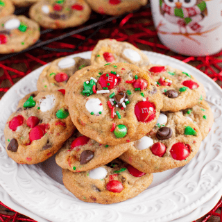Peppermint M&M Christmas Cookies with sprinkles and chocolate chips, are soft and chewy, and full of Christmas cheer! These might be Santa's favorite cookies! #christmascookies #sprinklecookies #funfetticookies #santasfavoritecookies