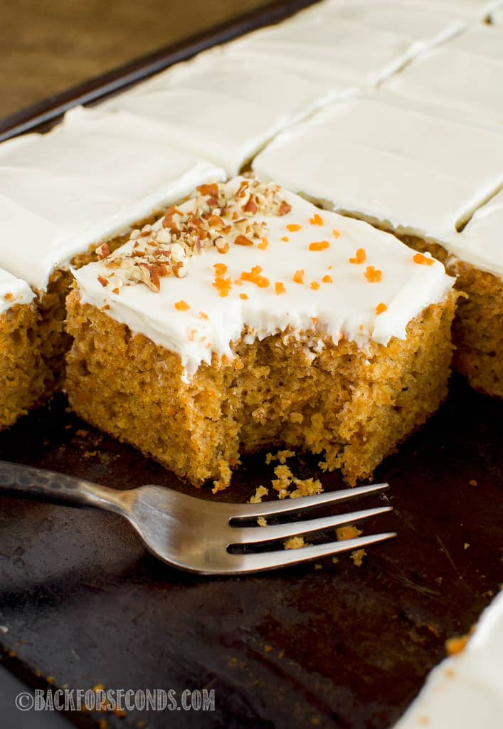 carrot cake with cream cheese frosting with fork bite