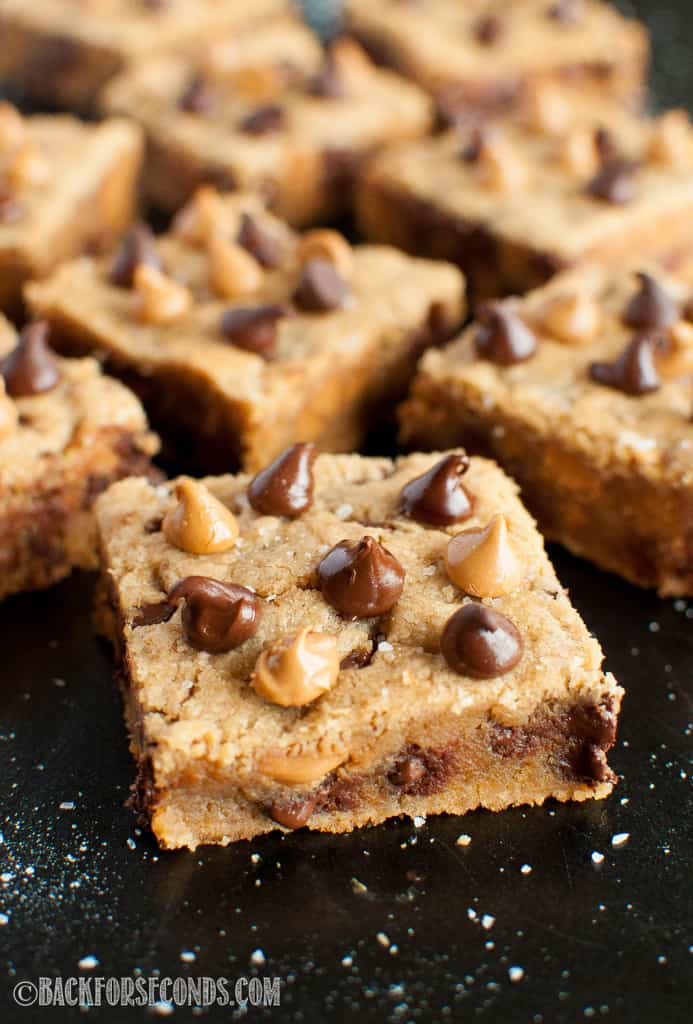 Melty Salted Peanut Butter Chocolate Chip Cookie Bars on a cookie sheet