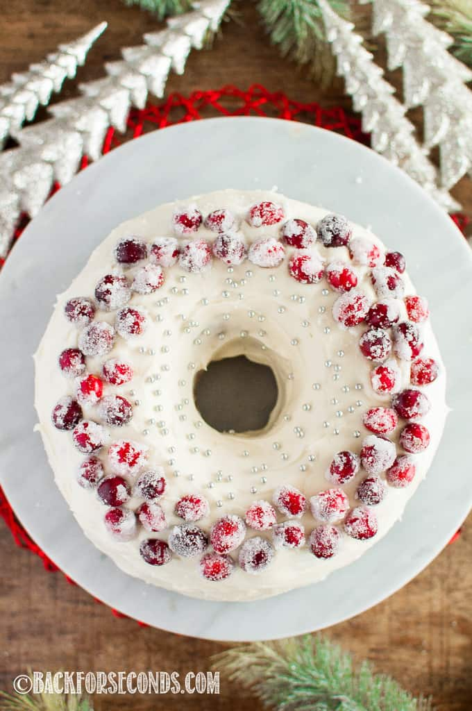 Top view Cranberry Christmas Cake with Cream Cheese Frosting and sugared cranberries on top