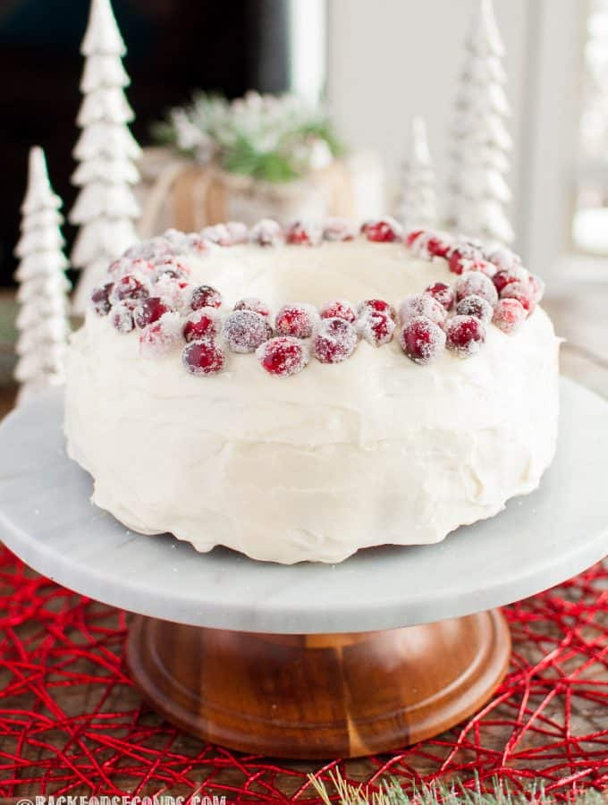Cranberry Christmas Cake with Cream Cheese Frosting and sugared cranberries on top