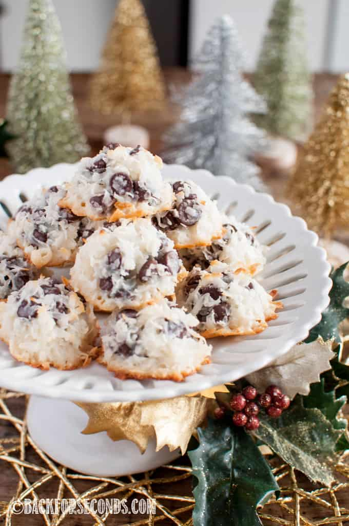 Chocolate Chip Macaroonsstacked on a white cake stand with Christmas decorations