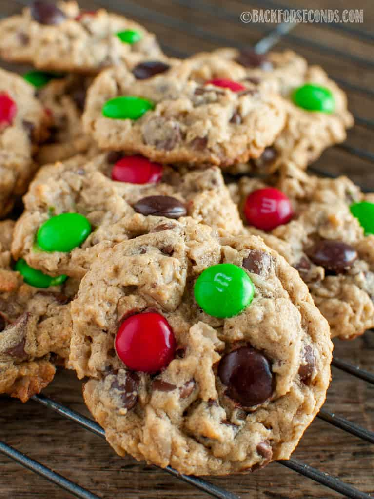 Best Christmas Monster Cookies piled on a cookie rack