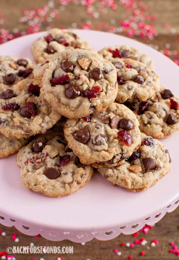 Cranberry Toffee Cranberry Cookies on a pink cake stand, front view