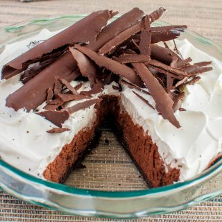 French silk pie in pie plate with one slice removed